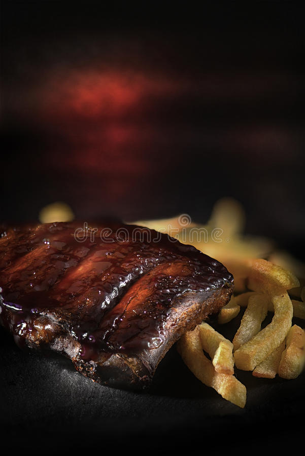 Pork Ribs And Fries royalty free stock images