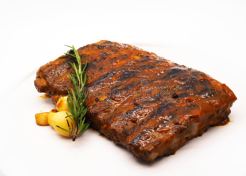 Pork Ribs Grill, Grilled and smoked ribs with barbeque sauce royalty free stock photos