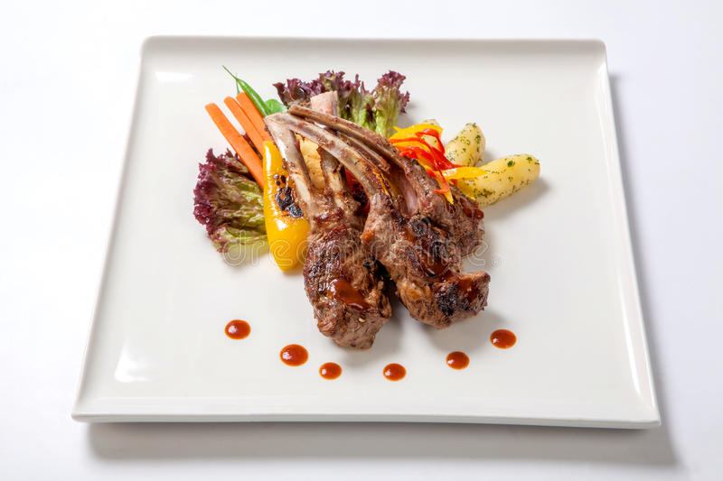 Pork ribs grilled with roasted vegetables and boiled potatoes stock photo