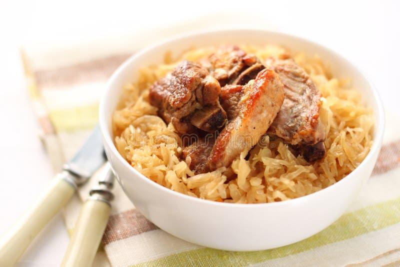 Pork ribs with sauerkraut stock photography