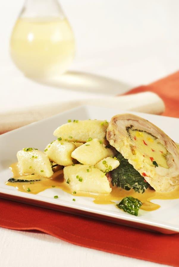 Pork roll with potato dumplings. Slice of pork roll with potato dumplings royalty free stock image