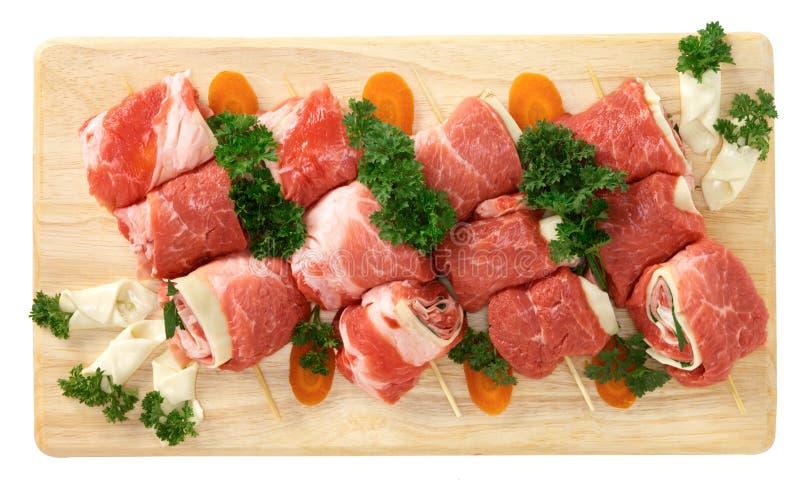 Pork rullar med ost- och krukaörtar royaltyfri foto