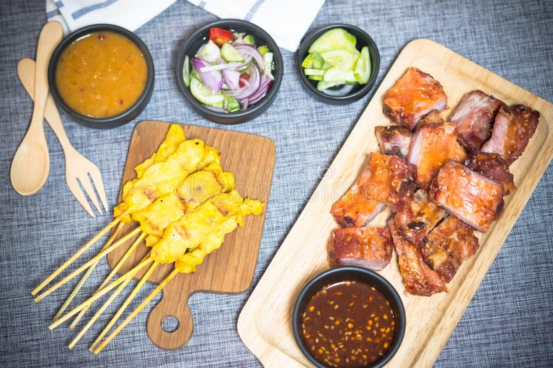 Pork satay served with roasted ribs stock image