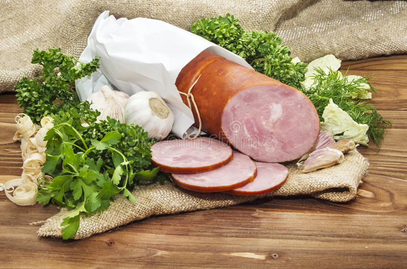 Pork sausage sliced in small pieces in a white packing royalty free stock photography