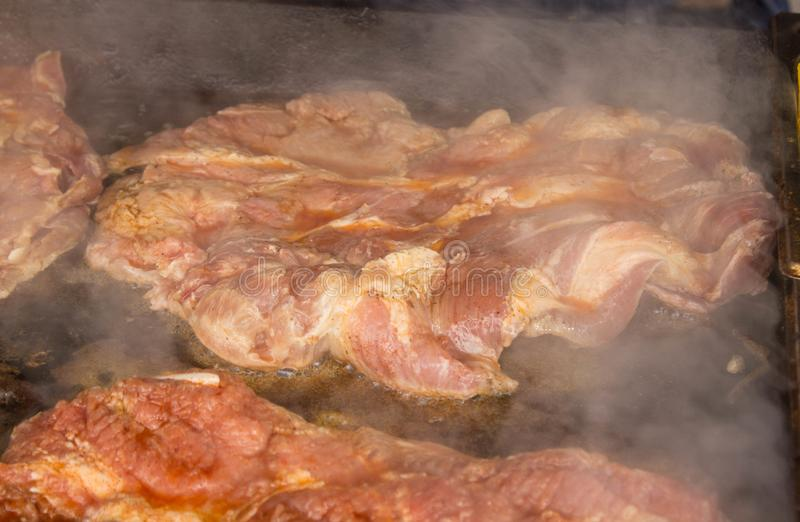 Pork Shoulder Meat Cut Sizzling on Grill stock photo