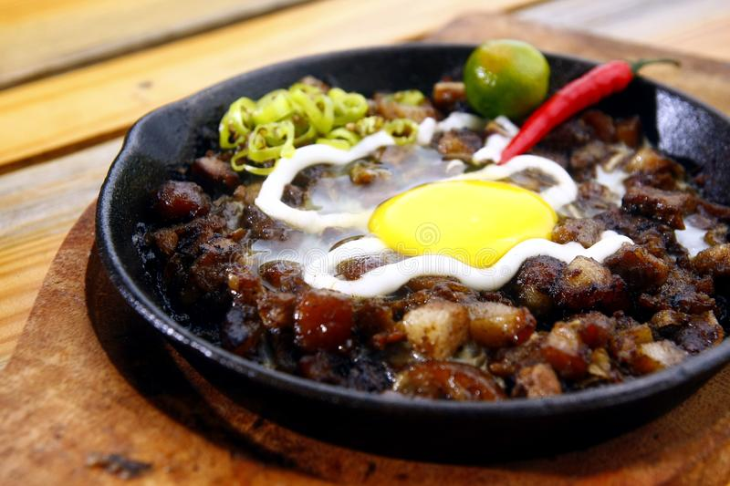 Pork sisig on a sizzling plate stock photography