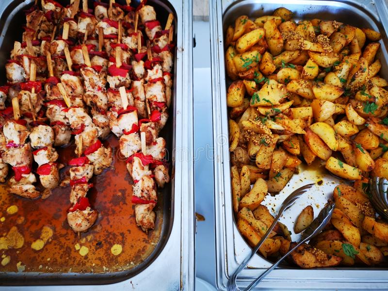 Pork skewer with vegetables and potatoes stock photography