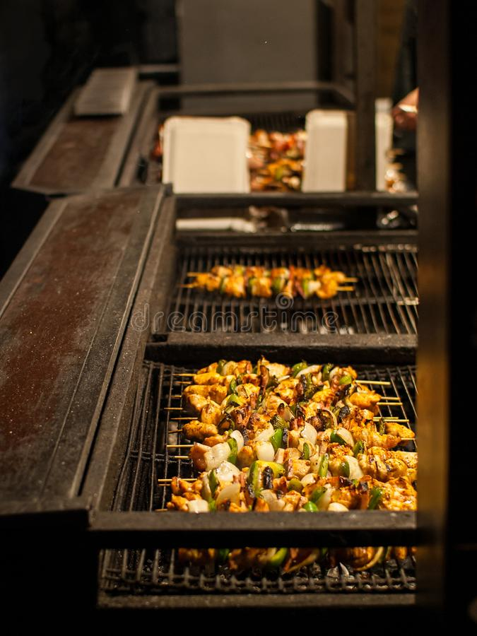Pork skewers with vegetables on an open fire. Old Town Square, Prague, Czech republic. Christmas market stock photo