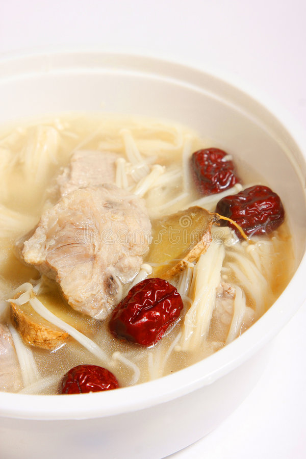Pork soup with red jujube and needle mushroom royalty free stock image