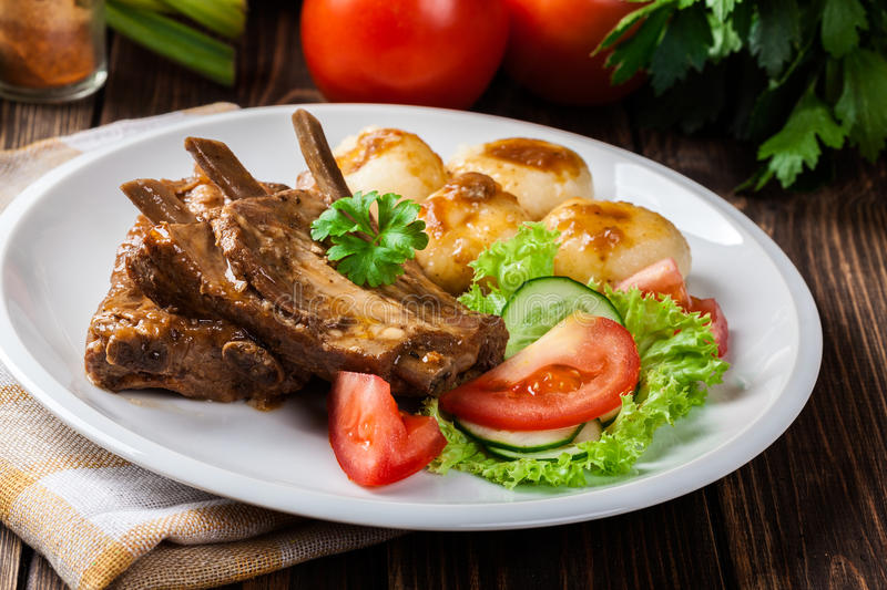 Pork spareribs served with silesian noodles and sauce. Selective focus royalty free stock images