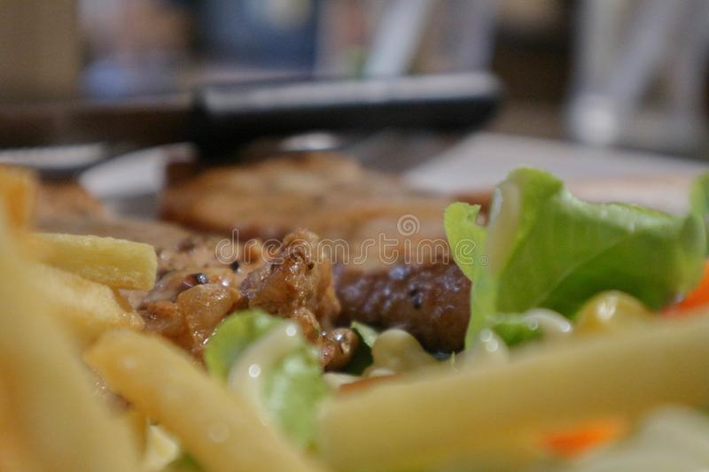 Pork steak and a delicious dinner with a good atmosphere royalty free stock images
