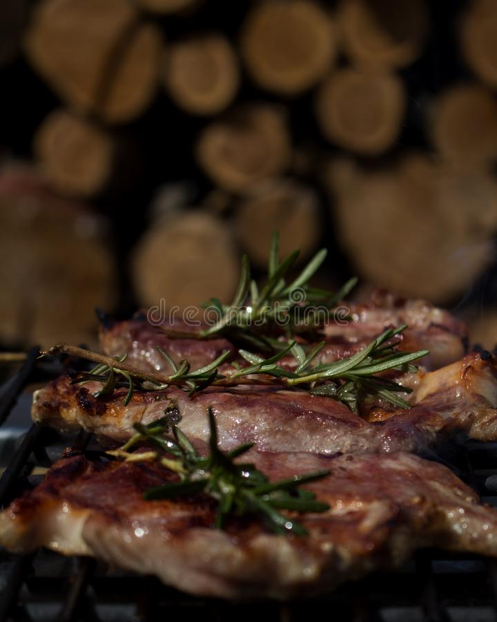 Pork Steaks With Rosemary Grilling on Hot Barbecue. Pork Steaks With Rosemary Grilling on a Hot Barbecue stock images