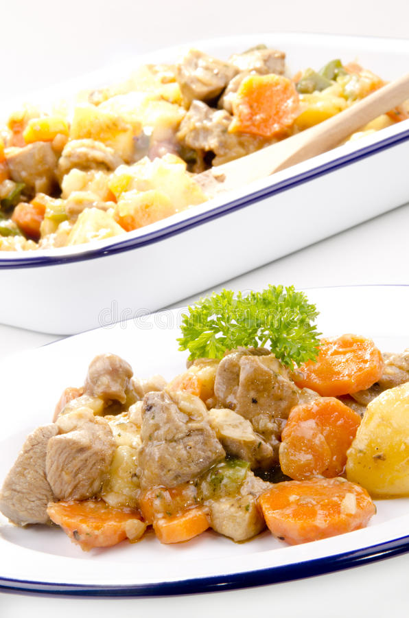 Pork stew with carrots stock image