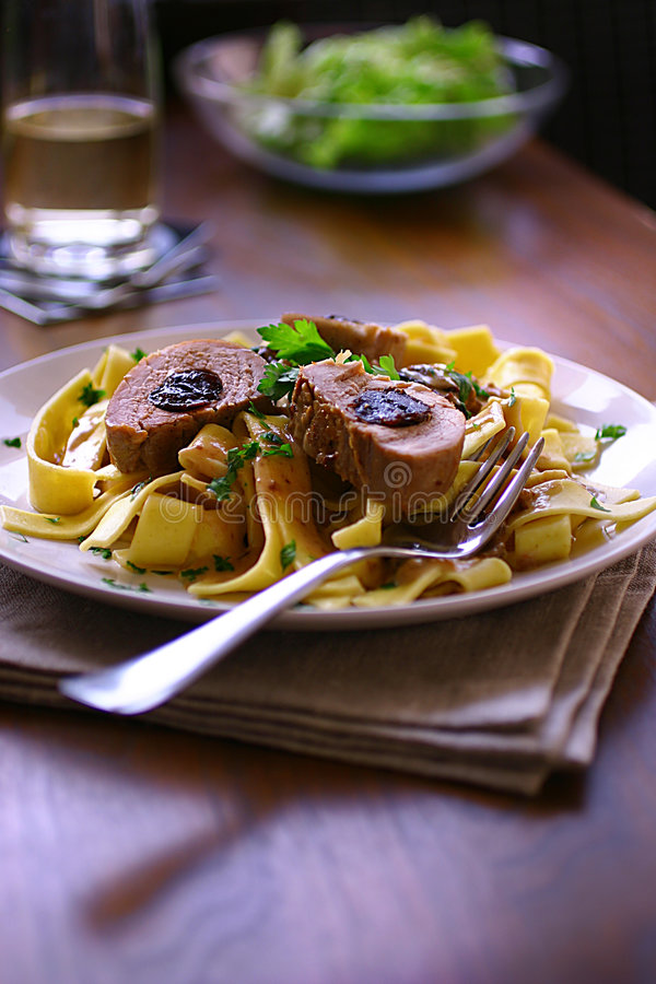 Pork stuffed with plums in cream sauce. On plate royalty free stock photos