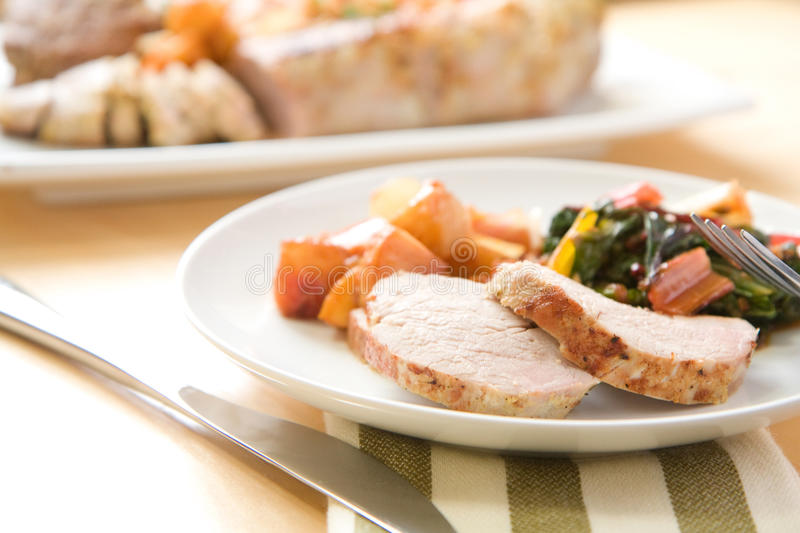 Pork Tenderloin. Served with peach tomato compote and swiss chard royalty free stock photos