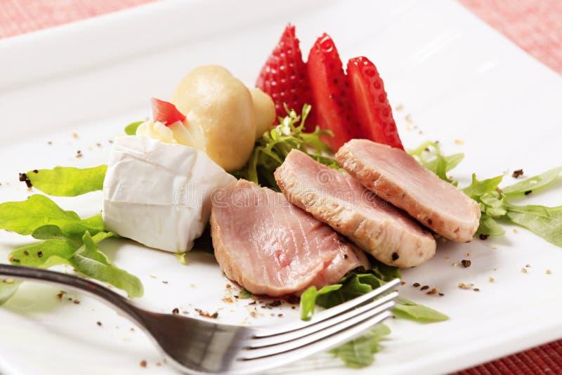 Pork tenderloin. Slices of roasted pork tenderloin and accompaniment stock photos