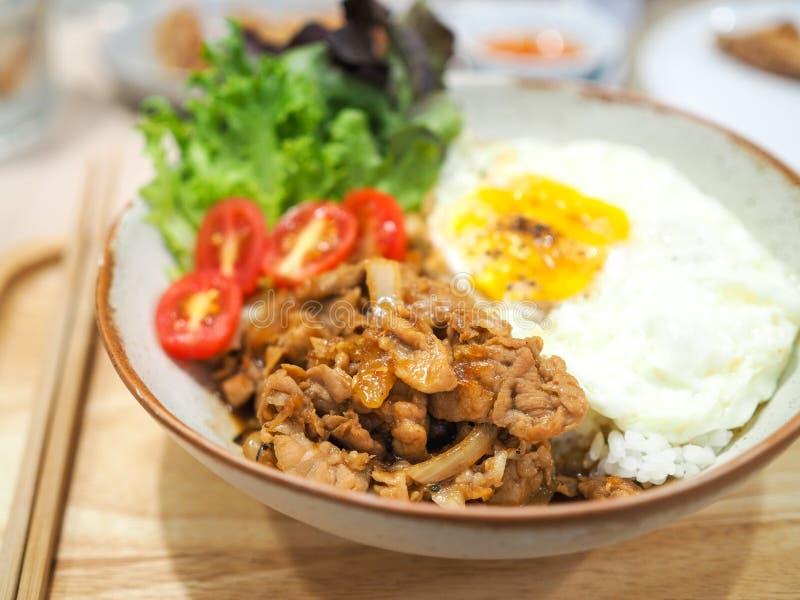 Pork teriyaki with rice and fried egg stock image