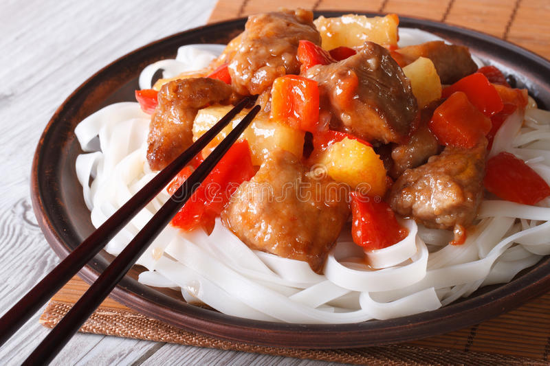Pork with vegetables and rice noodles close up horizontal stock photography