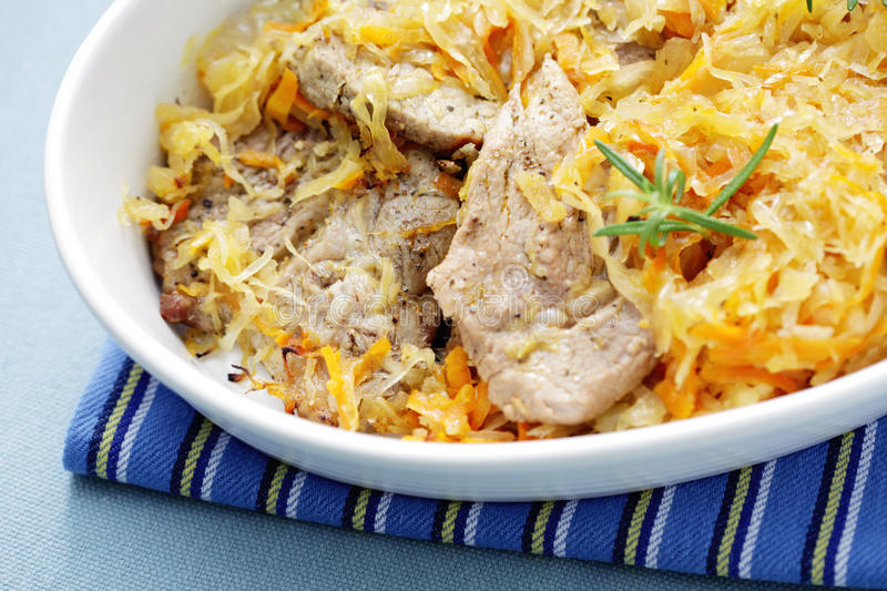 Porkneck with sauerkraut royalty free stock photography
