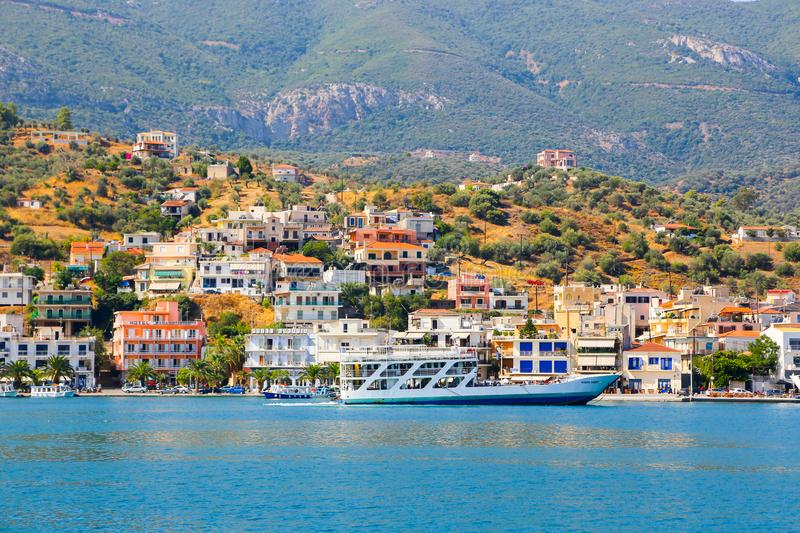 Poros island, Greece. JUNE 13 2015 Many tourists visiting and shopping at market street in old town royalty free stock photos