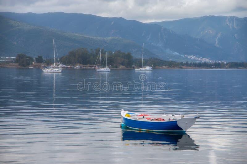 Blue boat poros stock images
