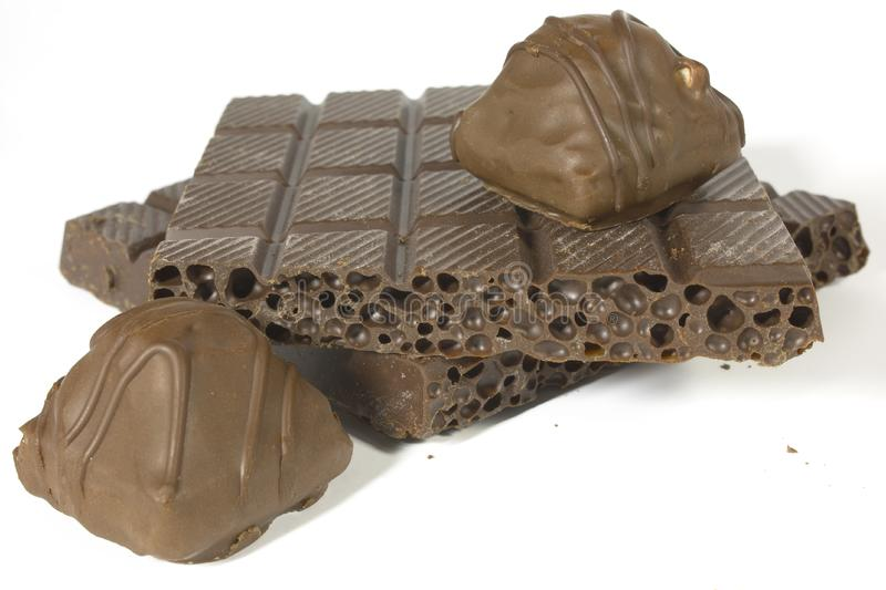 Porous chocolate and sweet chocolate stock images