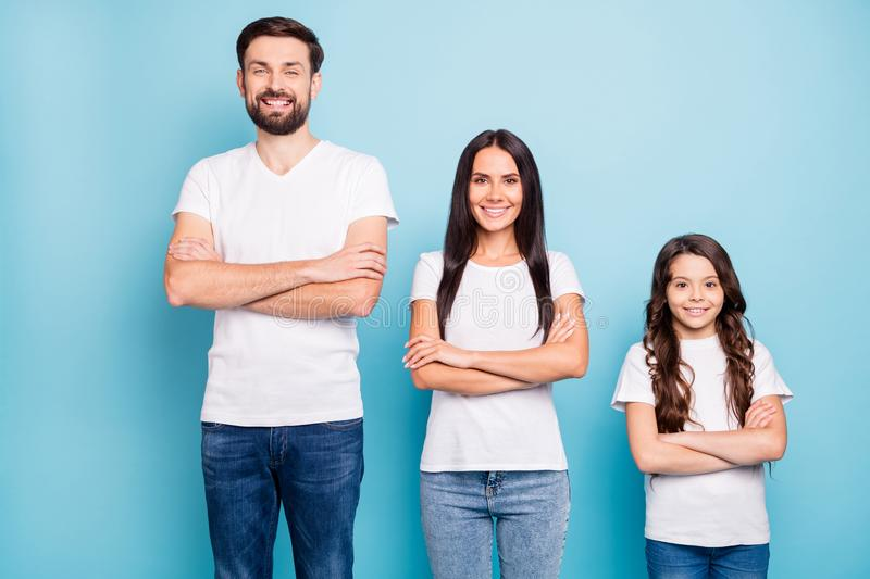 Porrait of positive cheerful three people true entrepreneurs ready to solver problems wear white t-shirt denim jeans royalty free stock photography
