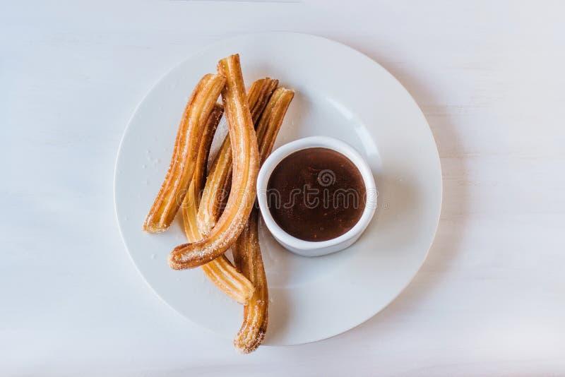 Porras Espagne de chocolat d'escroquerie de Churros image stock