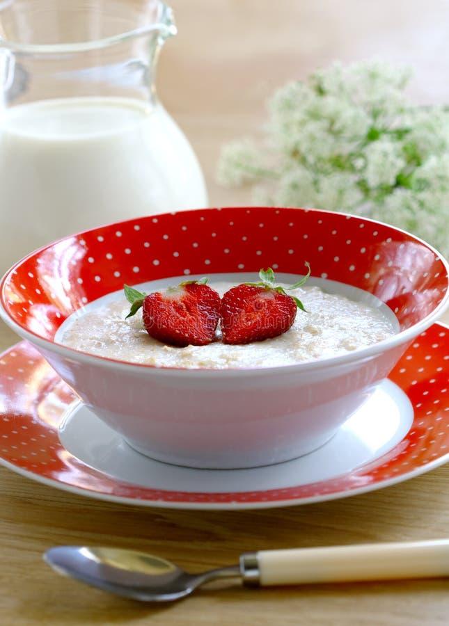 Porridge with berries strawberry royalty free stock photos