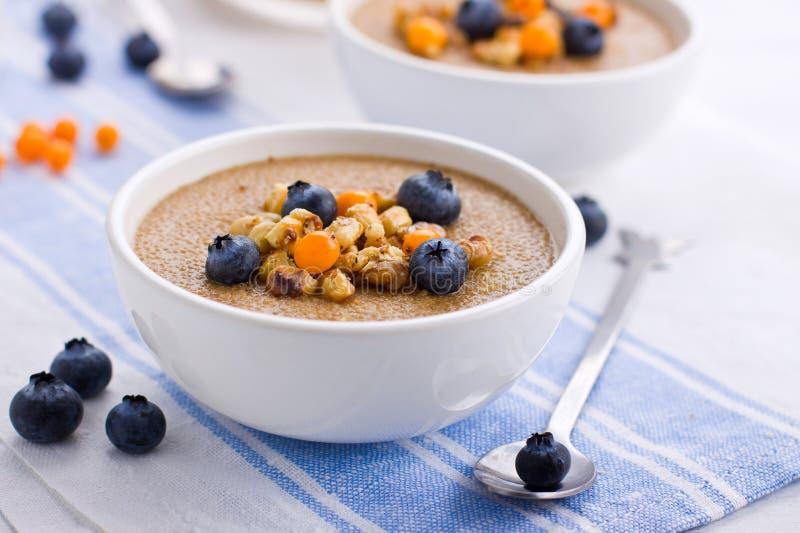 Porridge. Close up of a small bowl with amaranth porridge royalty free stock images