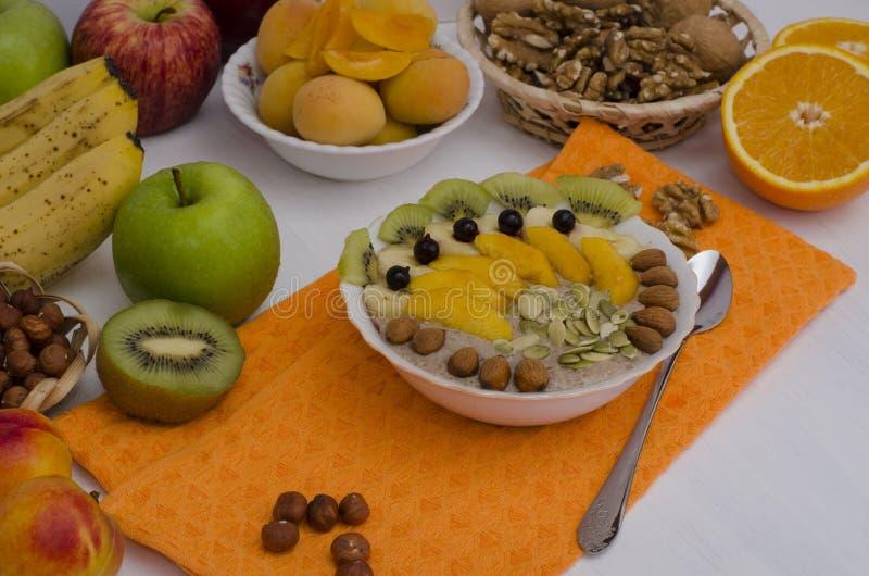 Porridge with fruit, berries, nuts, seeds. Breakfast stock images