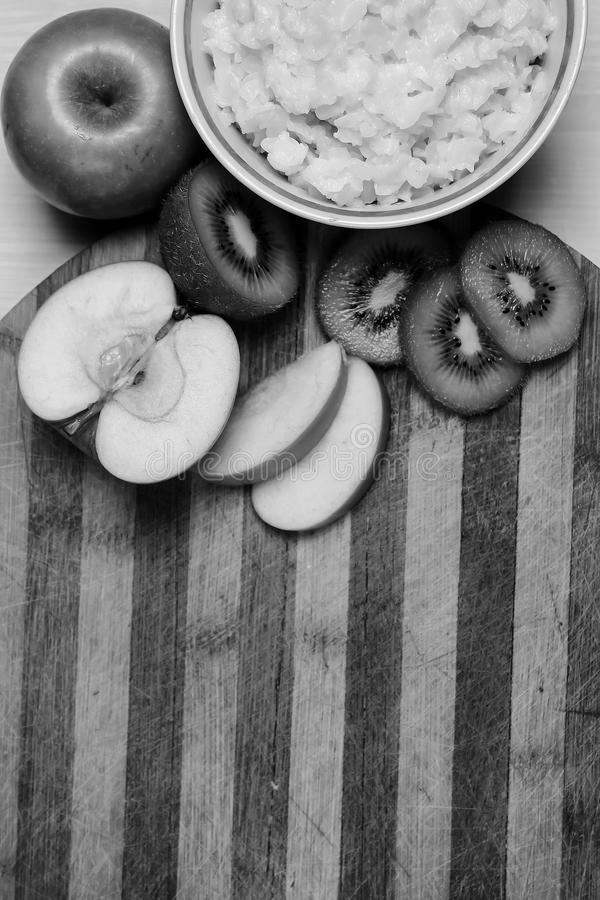 Porridge with fruit on the table. Black and white poster royalty free stock image