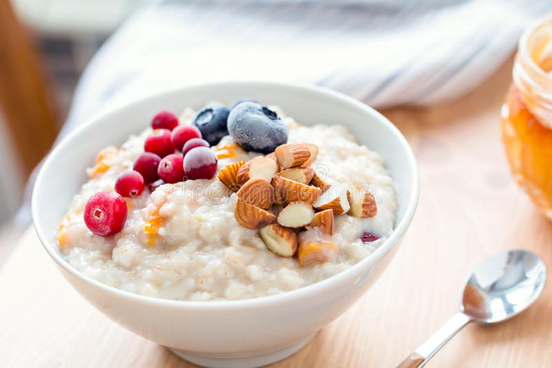 Porridge oats with almonds and berries, close up stock images