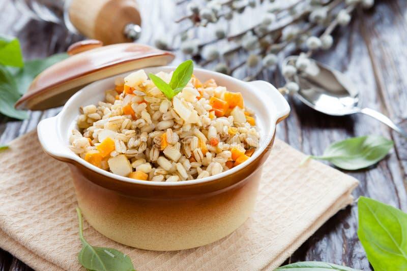 Porridge prepared from pearl barley. Closeup stock photos