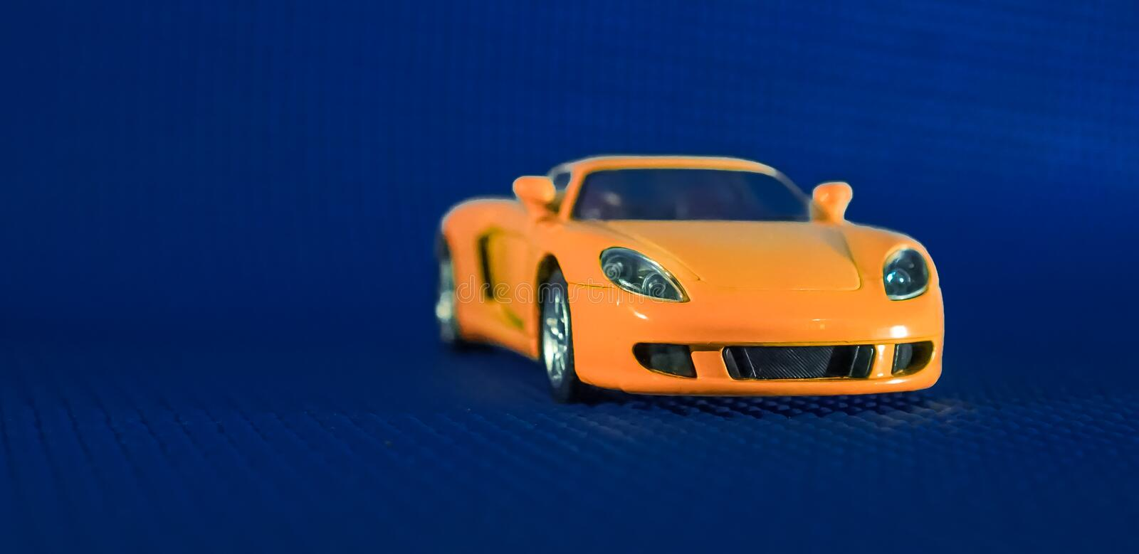 Porsche 911 Spyder sports car concept in orange color body. Porsche's petrol engine 911 roadster is an ultimate luxury cum race car which is one royalty free stock images
