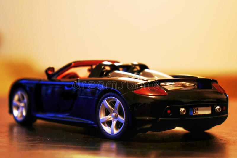 Porsche Carrera GT model racing car 1:24. Porsche Carrera GT sport car - die-cast metal model toy 1:24 scale, Black. Lateral / rear view stock image