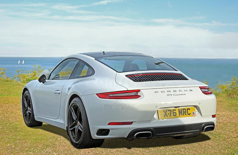 Porsche carrera sports car by the sea royalty free stock photo