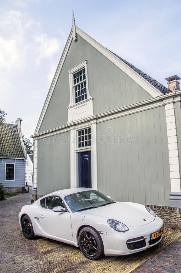 Free Porsche Cayman S In Front Of And Old Wooden House At Broek In Waterland 2018 Stock Photography - 125331062