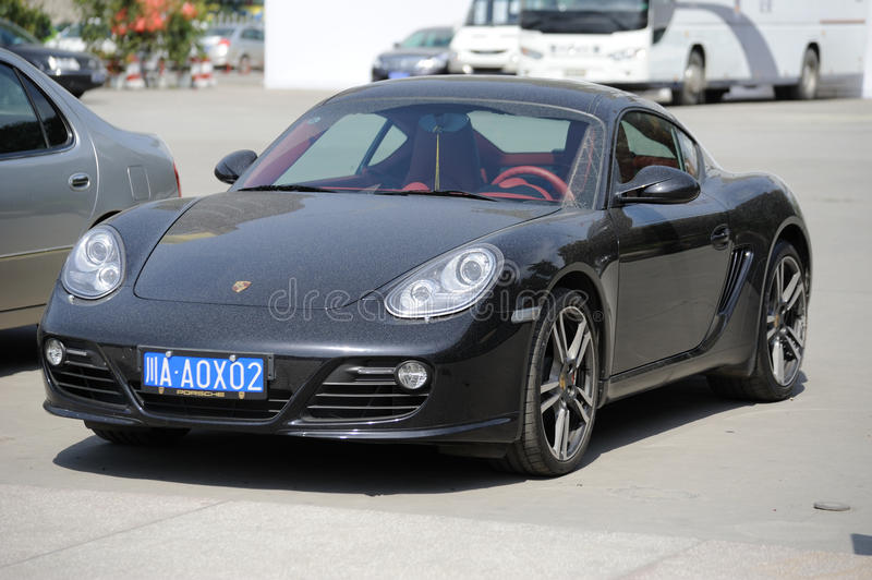 Porsche Cayman S In The Park. Editorial Stock Photo
