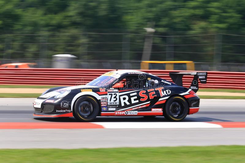 Porsche Cayman S race car. Jack Baldwin races the Porsche Cayman S for the Reset MD Race team at the professional motorsports racing event, International Motor royalty free stock photos