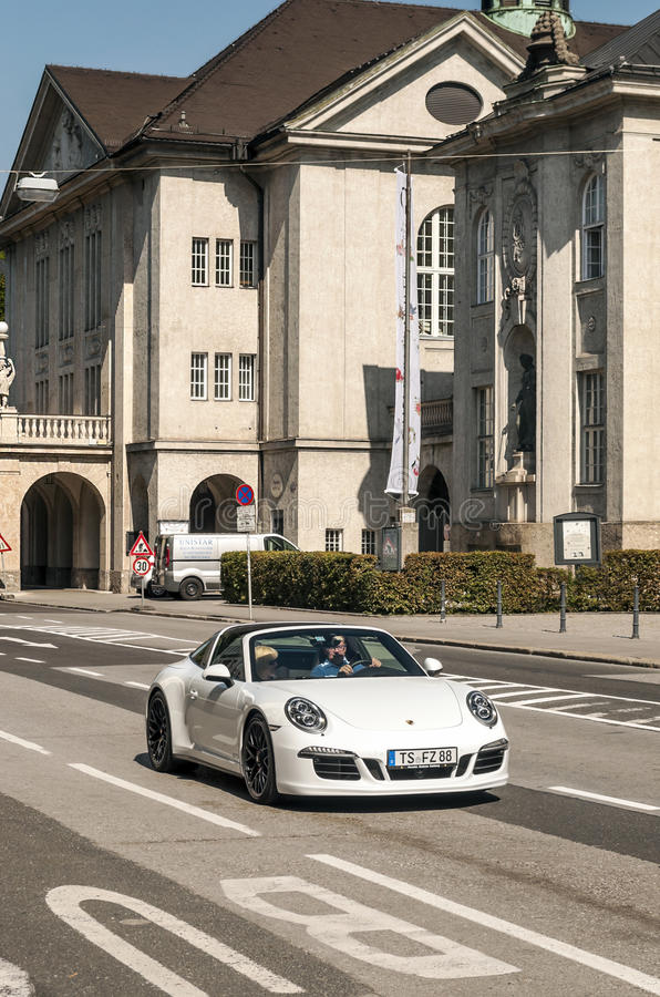 Porsche circulating in the streets of Salzburg. In Austria. It is an editorial image vertically on a sunny day stock photo