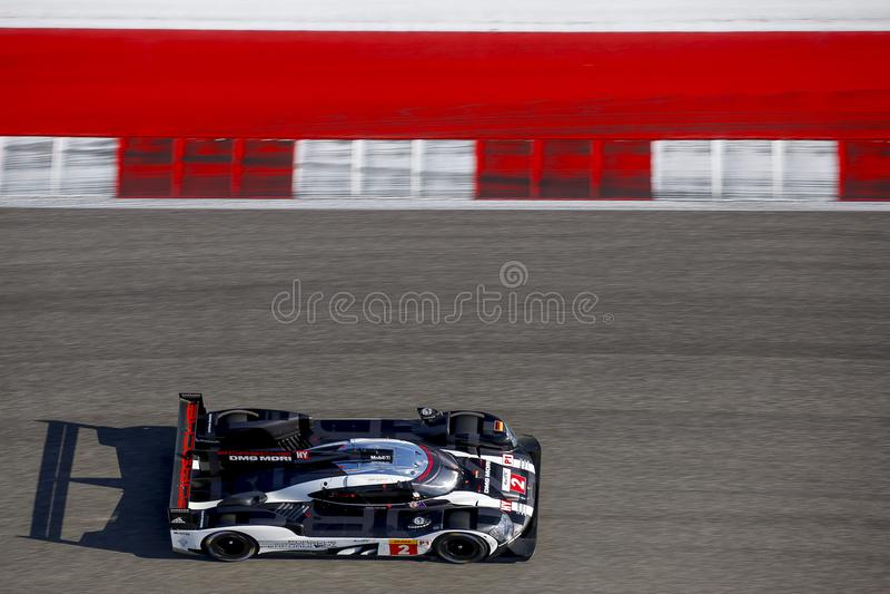A PPorsche LMP1 Race Car Speeds Along A Straightaway During A Sports Car  Race In Texas.