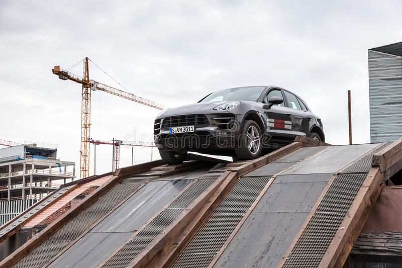 Porsche Macan at the offroad parcours. FRANKFURT, GERMANY - SEP 22: New Luxury Porsche Macan SUVs driving at an offroad parcours at the IAA International Motor royalty free stock photography
