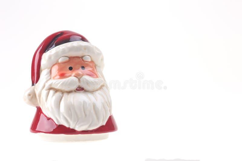 Porslin röda Santa Claus isolerade royaltyfri fotografi