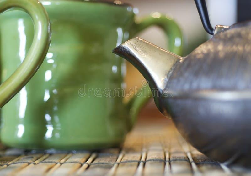 porslinet shoppar tea royaltyfria bilder