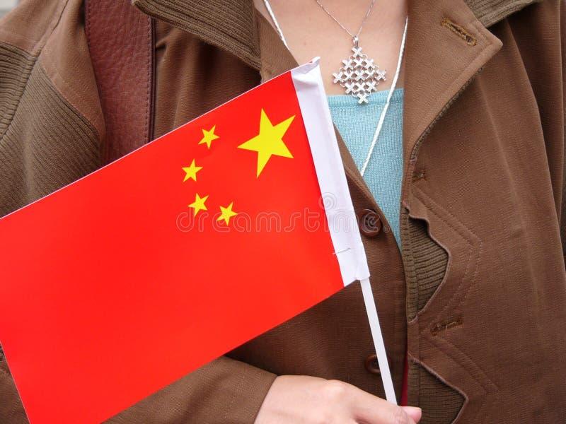 Download Porslinflagga arkivfoto. Bild av rött, kines, hand, välkomnande - 275830