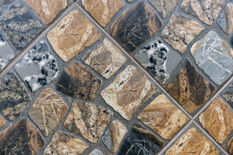 Porslinstengodstegelplattor av olika former och format för stenar royaltyfri bild