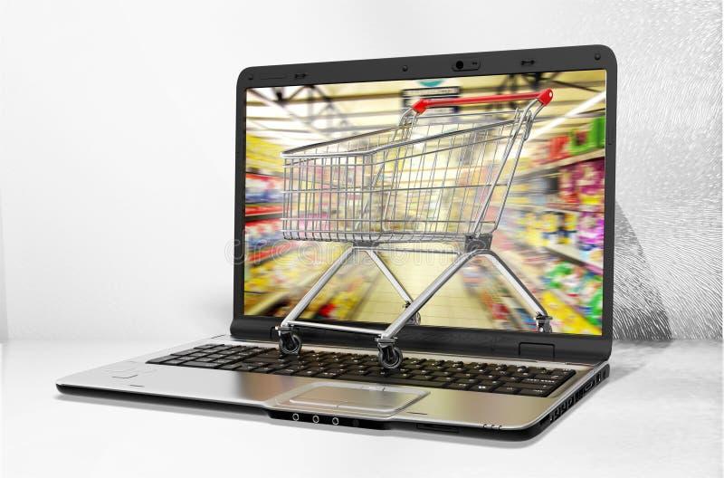 Portátil e carrinho de compras no fundo claro fotos de stock royalty free