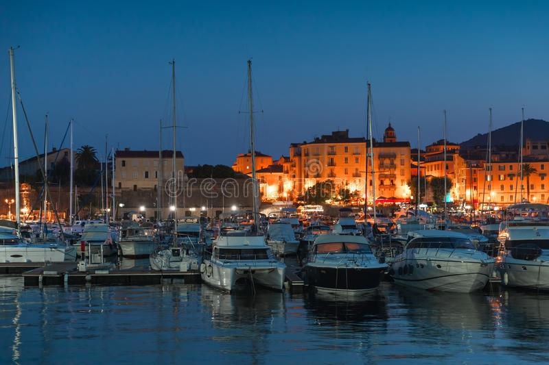 Port of Ajaccio at night, Corsica island. Pleasure yachts and motor boats moored in port of Ajaccio at night, Corsica island, France royalty free stock images