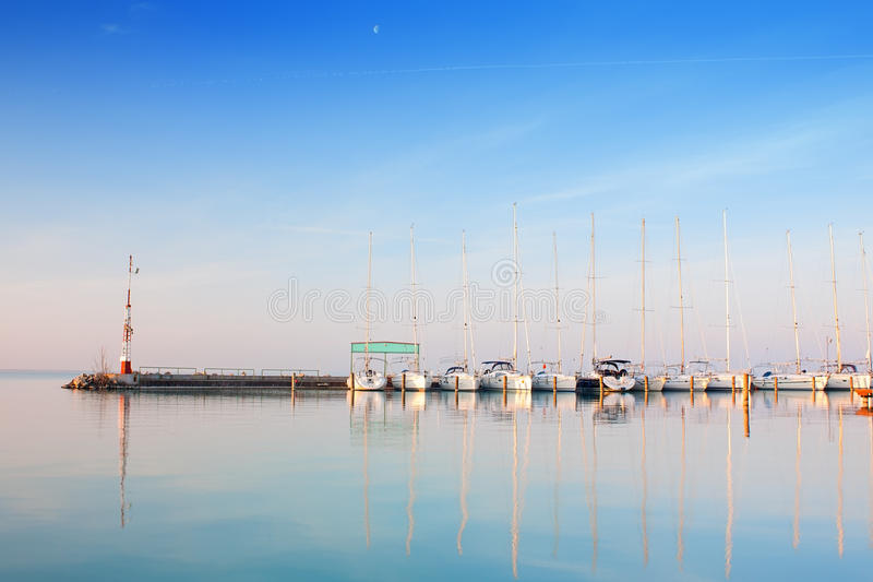 Port with anchored boats on lake Balaton royalty free stock photos